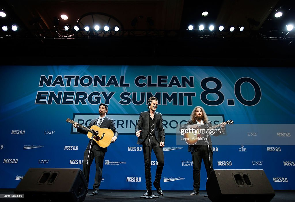 Guitarist Ted Sablay singer Brandon Flowers of The Killers and guitarist Jake Blanton perform during the National Clean Energy Summit 80 at the...