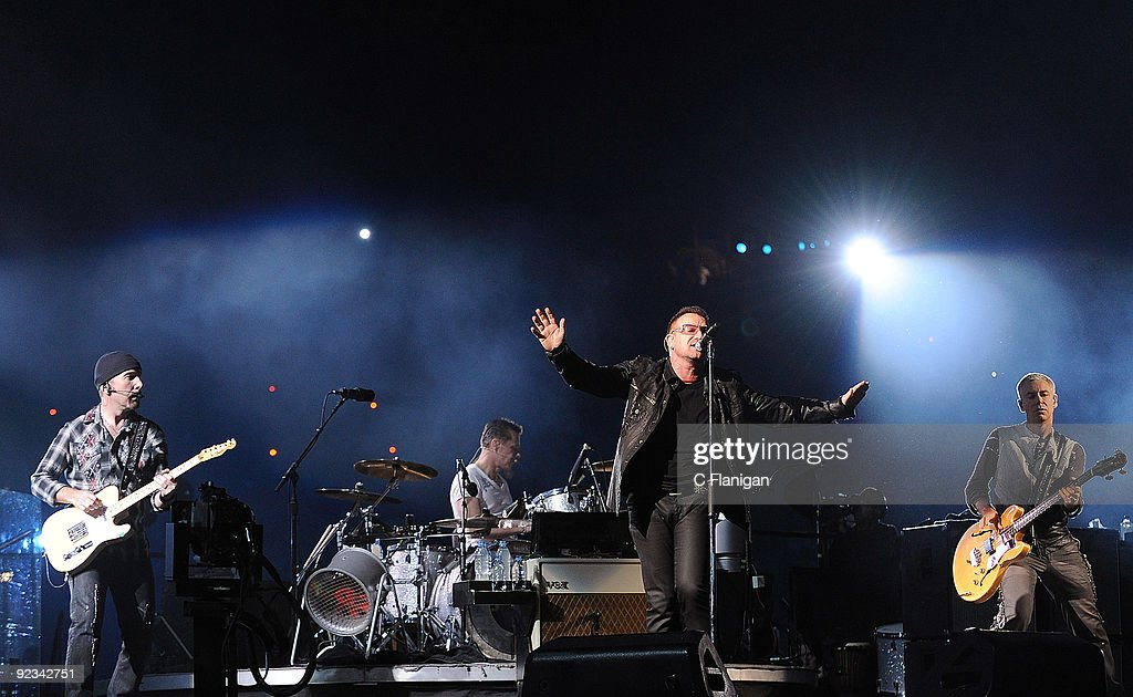 Guitarist The Edge Drummer Larry Mullen Jr Vocalist Bono and Bassist Adam Clayton of U2 perform during the 360 Degree Tour at Rose Bowl on October 25...