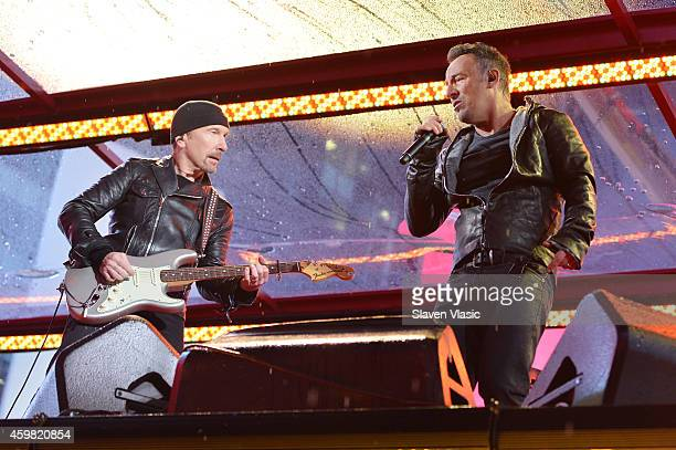 Guitarist The Edge of U2 and Bruce Springsteen perform on World AIDS Day at 'A Thank You' presented by RED on December 1 2014 in New York City Photo...