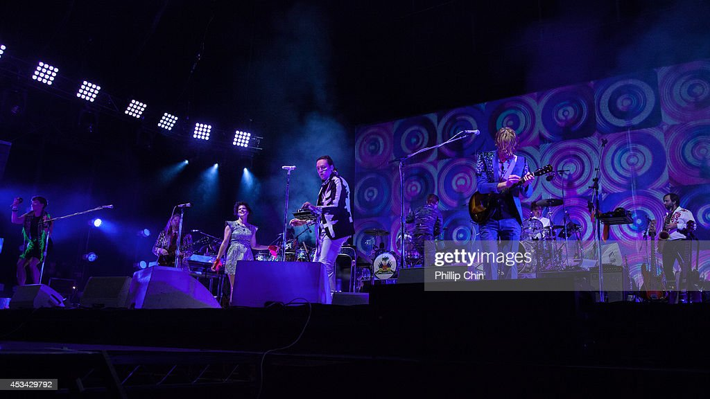 Guitarist Tim Kingsbury, percussionist Will Butler, singers Win Butler and Regine Chassagne and bassist Richard Reed Parry of Arcade Fire perform at Squamish Valley Music Festival on August 9, 2014 in Squamish, Canada.