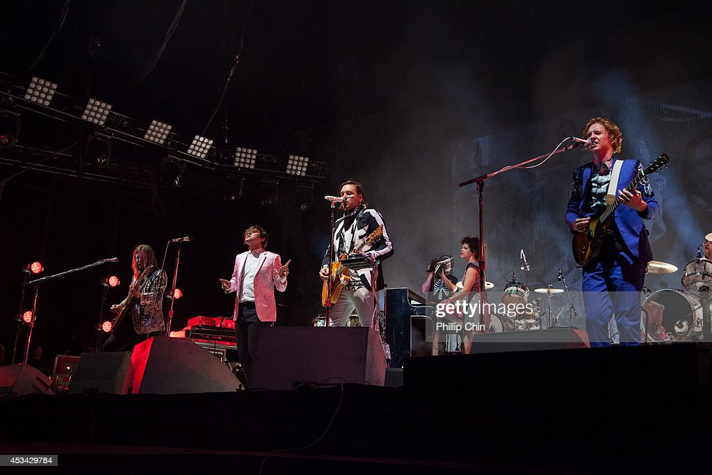 Guitarist Tim Kingsbury, singers Regine Chassagne, Win Butler, p bassist RIchard Reed Parry and drummer Jeremy Gara of Arcade Fire perform at Squamish Valley Music Festival on August 9, 2014 in Squamish, Canada.