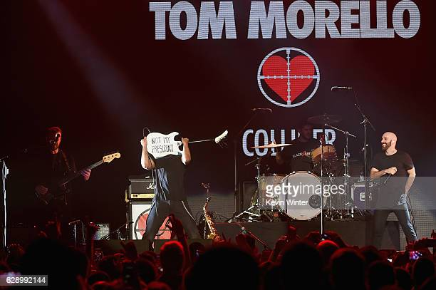 Guitarist Tom Morello performs onstage with Sam Harris right of the band X Ambassadors at 1067 KROQ Almost Acoustic Christmas 2016 Night 1 at The...