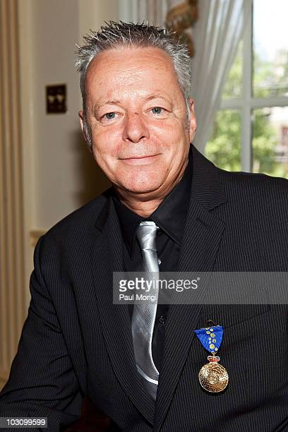 Guitarist Tommy Emmanuel AM poses for a photo after his appointment as a Member of The Order of Australia at the Australian Ambassador's Residence on...