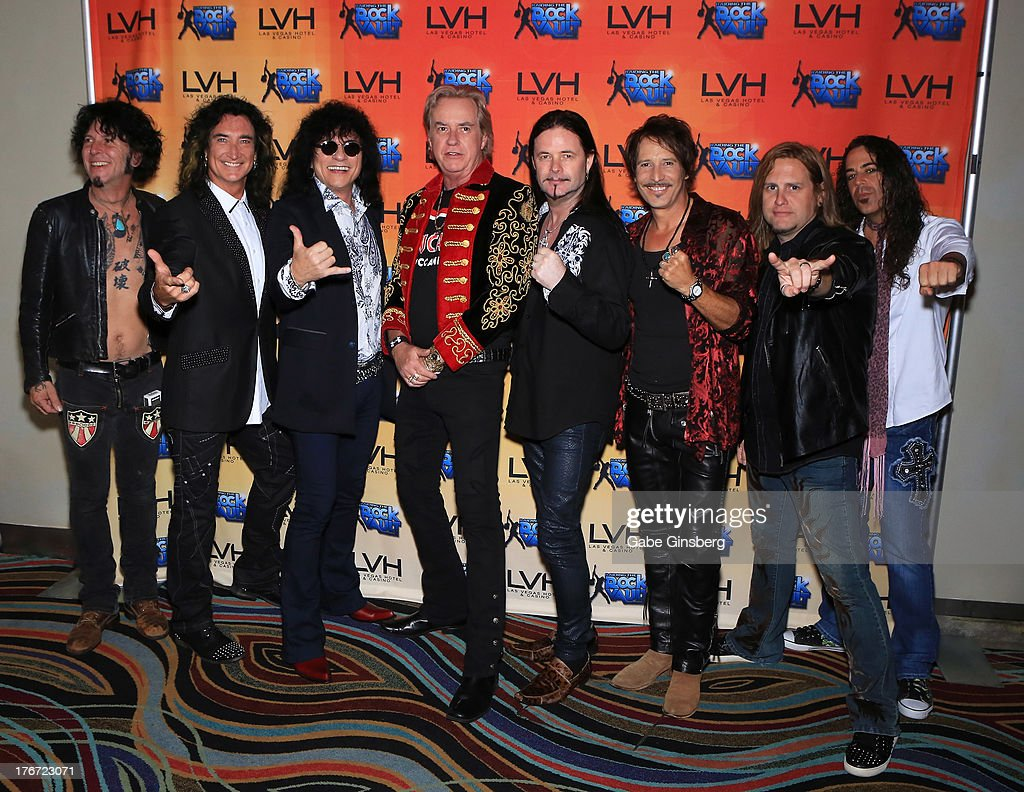 Guitarist Tracii Guns, singers Robin McAuley and Paul Shortino, guitarist Howard Leese, singer John Payne, drummer Jay Schellen, singer/guitarist Andrew Freeman and keyboardist Michael T. Ross arrive at the 'Night of the Champion' event to honor former boxer Leon Spinks hosted by the cast members of 'Raiding the Rock Vault' at The Las Vegas Hotel & Casino on August 17, 2013 in Las Vegas, Nevada.