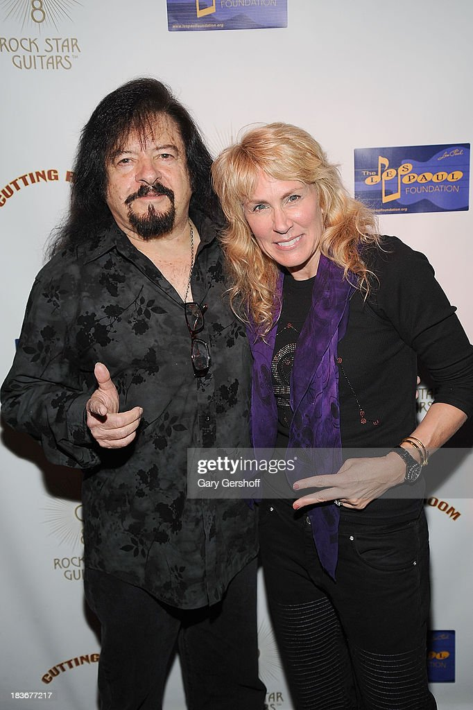 Guitarist Vinny Martell (L) and author and photographer Lisa Johnson attend the book launch and performance for '108 Rock Star Guitars' benefitting The Les Paul Foundation at The Cutting Room on October 8, 2013 in New York City.