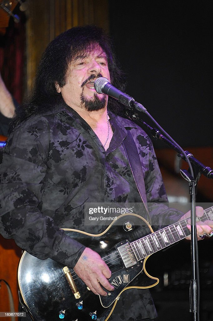 Guitarist Vinny Martell performs on stage for the book launch of '108 Rock Star Guitars' benefitting The Les Paul Foundation at The Cutting Room on October 8, 2013 in New York City.