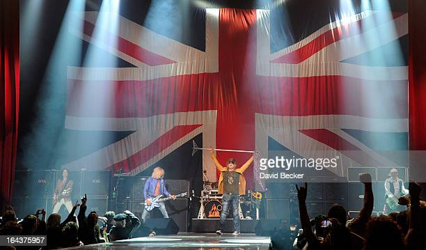Guitarist Vivian Campbell bassist Rick Savage singer Joe Elliott and Phil Collen of Def Leppard performs on the opening night of 'VIVA Hysteria' the...