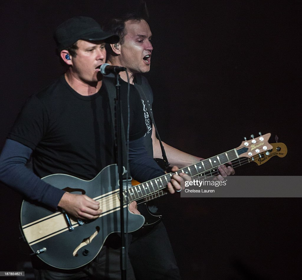 Guitarist / vocalist <a gi-track='captionPersonalityLinkClicked' href=/galleries/search?phrase=Tom+DeLonge&family=editorial&specificpeople=226802 ng-click='$event.stopPropagation()'>Tom DeLonge</a> (L) and bassist / vocalist <a gi-track='captionPersonalityLinkClicked' href=/galleries/search?phrase=Mark+Hoppus&family=editorial&specificpeople=211529 ng-click='$event.stopPropagation()'>Mark Hoppus</a> of Blink-182 perform at The Wiltern on November 12, 2013 in Los Angeles, California.
