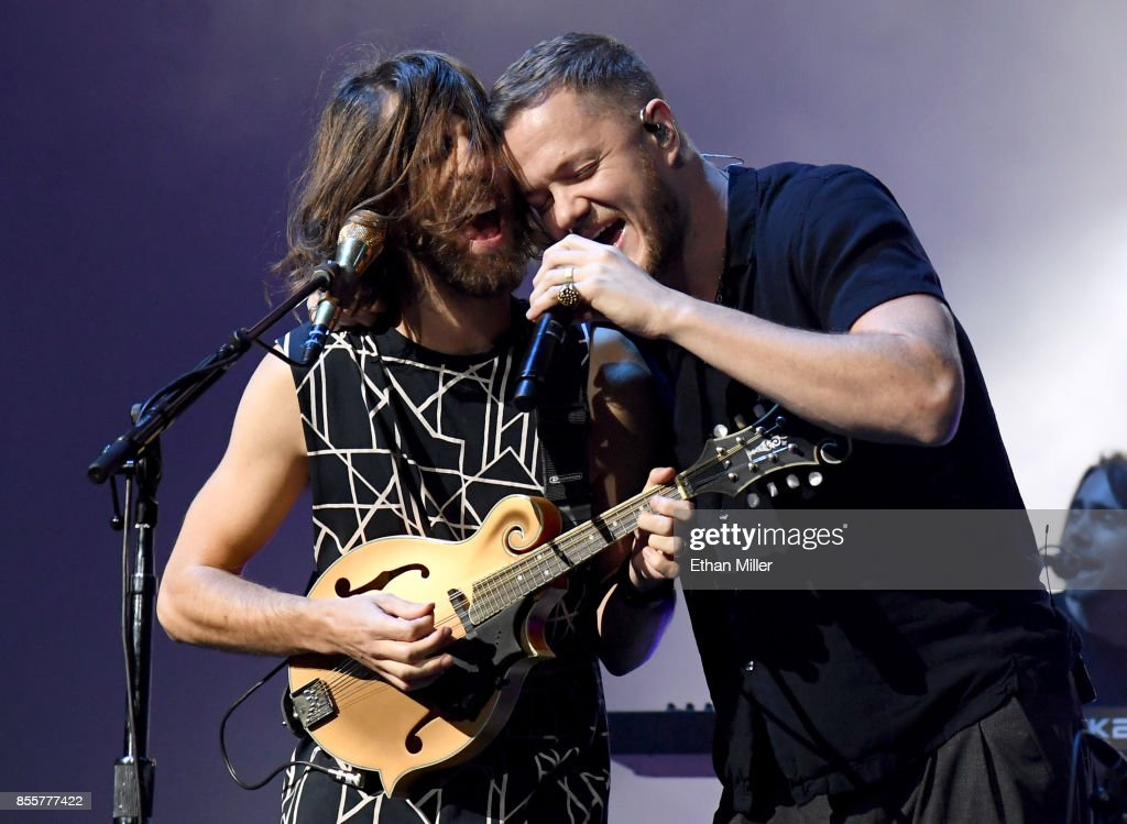 Guitarist Wayne Sermon (L) and frontman Dan Reynolds of Imagine Dragons perform during a stop of the band's Evolve World Tour at T-Mobile Arena on September 29, 2017 in Las Vegas, Nevada.
