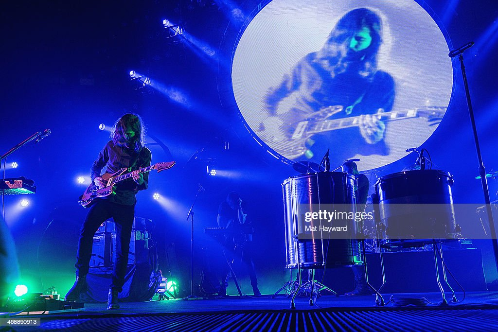 Guitarist Wayne Sermon of Imagine Dragons performs on stage at KeyArena on February 11, 2014 in Seattle, Washington.