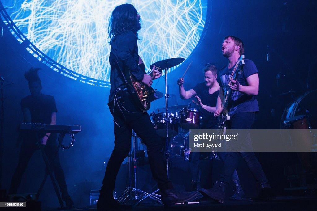 Guitarist Wayne Sermon, singer Dan Reynolds and bassist Ben McKee of Imagine Dragons perform on stage at KeyArena on February 11, 2014 in Seattle, Washington.