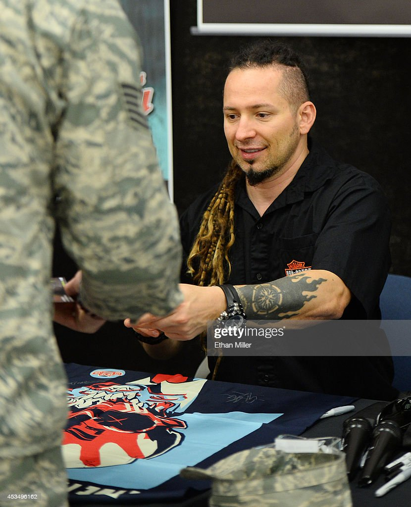 Guitarist Zoltan Bathory of Five Finger Death Punch signs autographs at Nellis Air Force Base as the band highlights its campaign to raise awareness about veterans suffering from post-traumatic stress disorder (PTSD), in part by launching the video 'Wrong Side of Heaven,' that deals with the subject on August 11, 2014 in Las Vegas, Nevada.