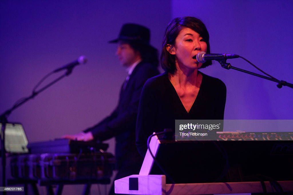 Guitarist/mini moog player Toko Yasuda performs at the American Express UNSTAGED Fashion with DVF at Spring Studios on February 9, 2014 in New York City.