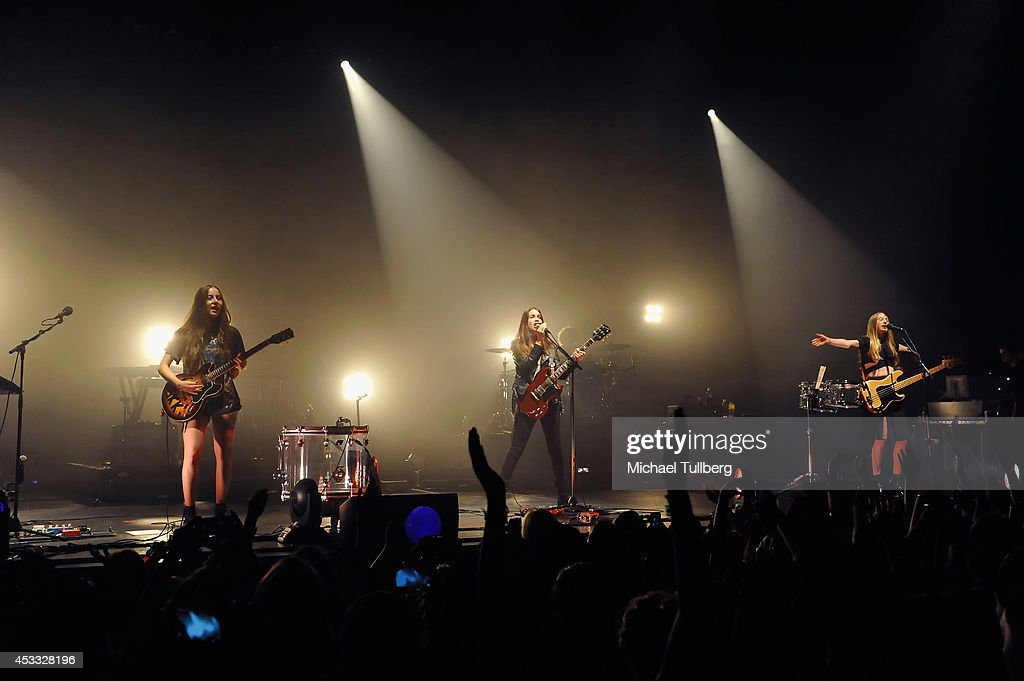 Guitarists <a gi-track='captionPersonalityLinkClicked' href=/galleries/search?phrase=Alana+Haim&family=editorial&specificpeople=9431818 ng-click='$event.stopPropagation()'>Alana Haim</a> and <a gi-track='captionPersonalityLinkClicked' href=/galleries/search?phrase=Danielle+Haim&family=editorial&specificpeople=2499485 ng-click='$event.stopPropagation()'>Danielle Haim</a> and bassist <a gi-track='captionPersonalityLinkClicked' href=/galleries/search?phrase=Este+Haim&family=editorial&specificpeople=2499486 ng-click='$event.stopPropagation()'>Este Haim</a> of the rock group HAIM perform at Wiltern Theatre on August 7, 2014 in Los Angeles, California.