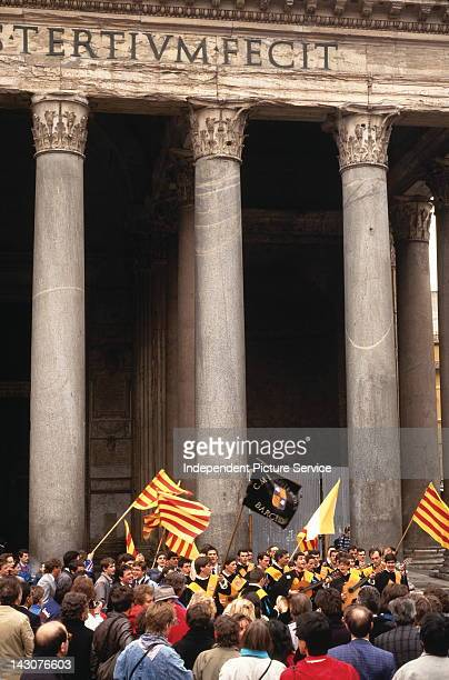 Guitarists and vocalists with flags of Catalonia in front of the Pantheon Rome Italy