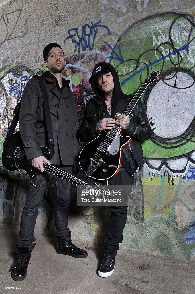 Guitarist's Billy Martin and Benji Madden of American pop punk group Good Charlotte outside the O2 Academy taken on February 8 2011 in Bristol