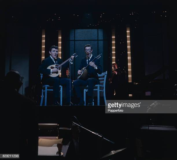 Guitarists Bruce Welch and Hank Marvin of The Shadows perform live on stage in England in 1963