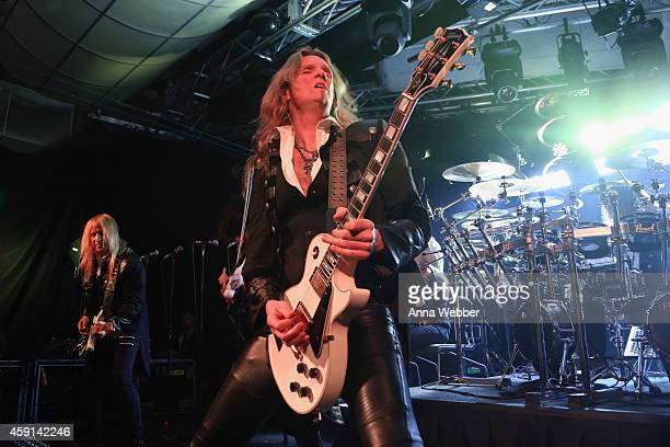 Guitarists Chris Caffery and Joel Hoekstra of TransSiberian Orchestra perform onstage during an exclusive performance at The iHeartRadio Theater in...