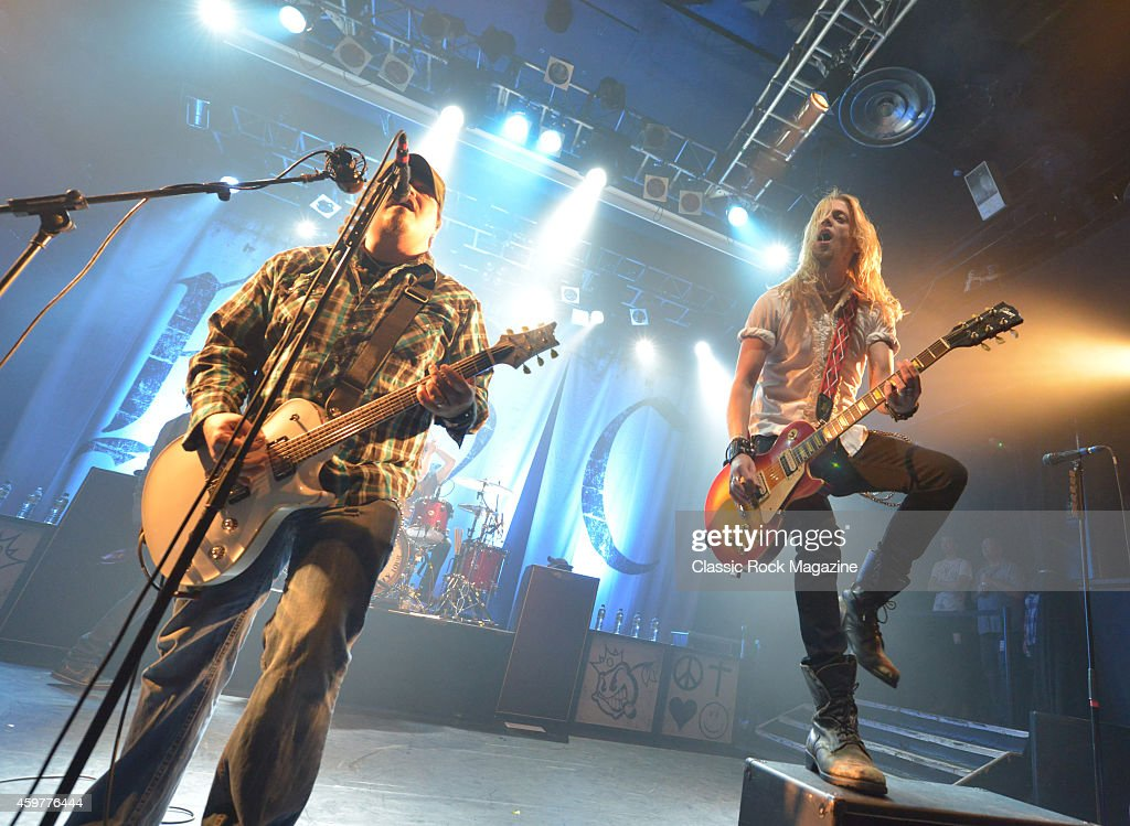 Guitarists Chris Robertson (L) and Ben Wells of American rock group Black Stone Cherry performing live on stage at KOKO in London, on February 28, 2014.