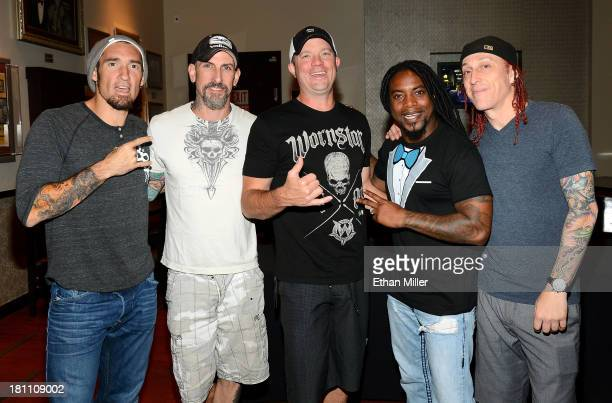 Guitarists Clint Lowery and John Connolly bassist Vince Hornsby singer Lajon Witherspoon and drummer Morgan Rose of Sevendust pose after performing...