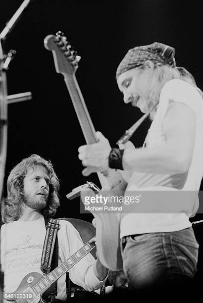 Guitarists Don Felder and Joe Walsh performing with American rock group The Eagles at Wembley Empire Pool London during their Hotel California tour...