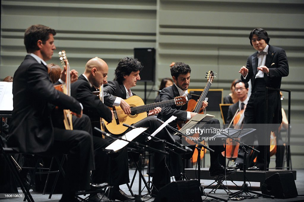 Guitarists Emmanuel Rossfelder, Fernando Espi, Juan Manuel Canizares, and Pablo Sainz Villegas perform with the Yokohama Sinfonietta conducted by Kazuki Yamada (R), on February 3, 2013, as part of the 'Folle Journee' music festival at the Cite des Congres in Nantes.