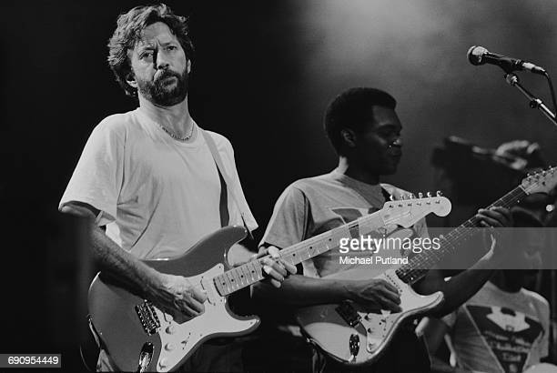 Guitarists Eric Clapton and Robert Cray performing on stage 1986