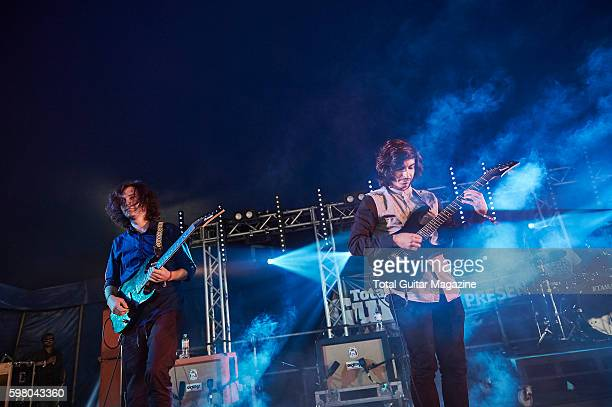 Guitarists Erick Hansel and Mario Camarena of American progressive rock group Chon performing live on stage at ArcTanGent Festival in Somerset on...