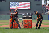 Guitarists James Hetfield and Kirk Hammett of Metallica perform The National Anthem at ATT Park on May 6 2016 in San Francisco California