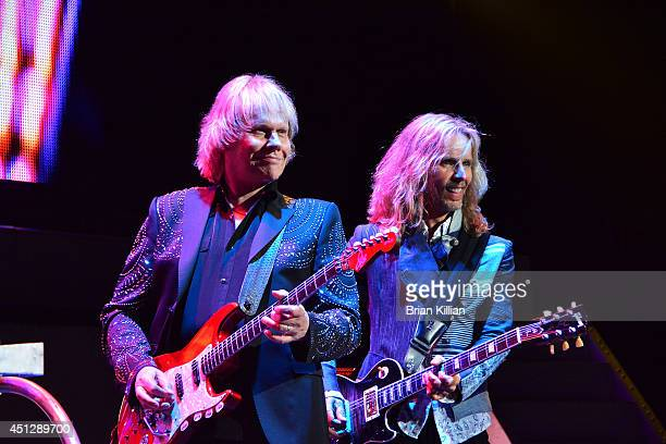 Guitarists James Young and Tommy Shaw of the group Styx perform at Prudential Center on June 26 2014 in Newark New Jersey
