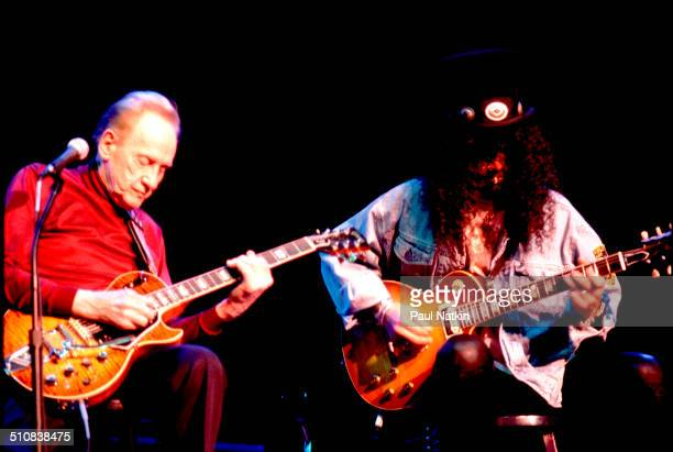 Guitarists Les Paul and Slash perform together onstage at the House of Blues Chicago Illinois December 2 1996