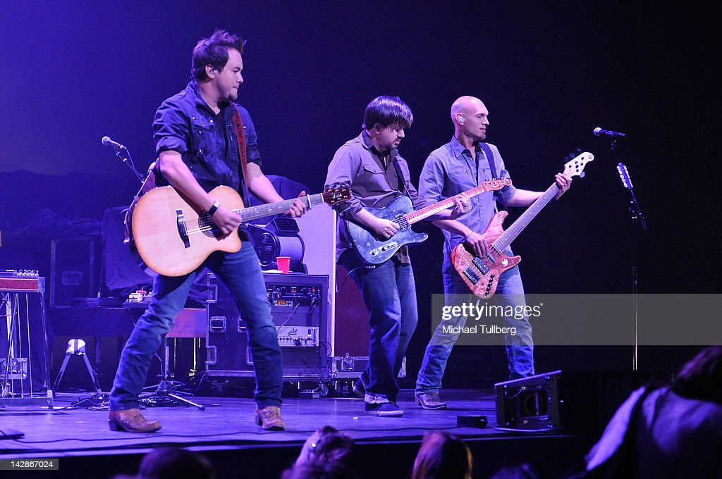 Guitarists Mike Eli, <a gi-track='captionPersonalityLinkClicked' href=/galleries/search?phrase=Keith+Davis&family=editorial&specificpeople=580211 ng-click='$event.stopPropagation()'>Keith Davis</a> and bassist Jon Jones of the Eli Young Band perform live at Nokia Theatre L.A. Live on April 13, 2012 in Los Angeles, California.