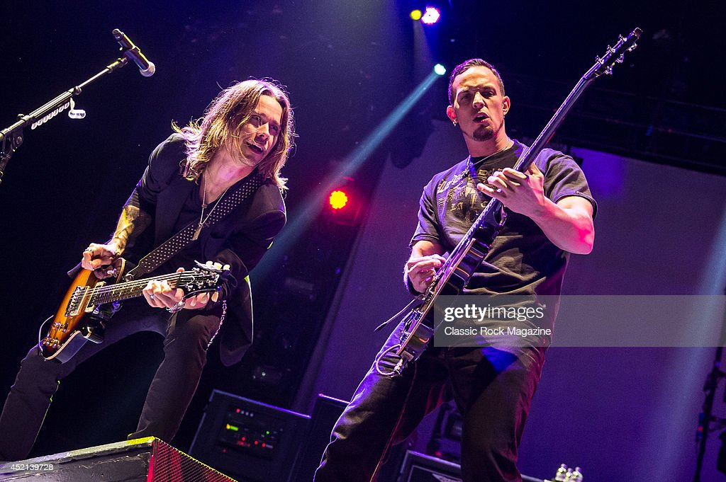 Guitarists Myles Kennedy (L) and Mark Tremonti of American rock group Alter Bridge performing live on stage at Wembley Arena in London, on October 18, 2013.