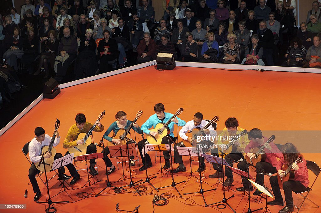 Guitarists of the conservatory in Nantes perform during the 'Folle Journee' classic music festival on February 1, 2013 in Nantes. The 19th edition of this festival will run until February 3. AFP PHOTO FRANK PERRY