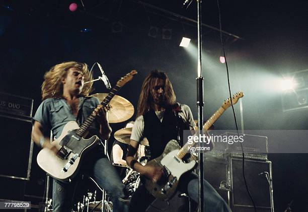Guitarists Rick Parfitt and Francis Rossi of English rock group Status Quo performing at the Hammersmith Odeon London 1976