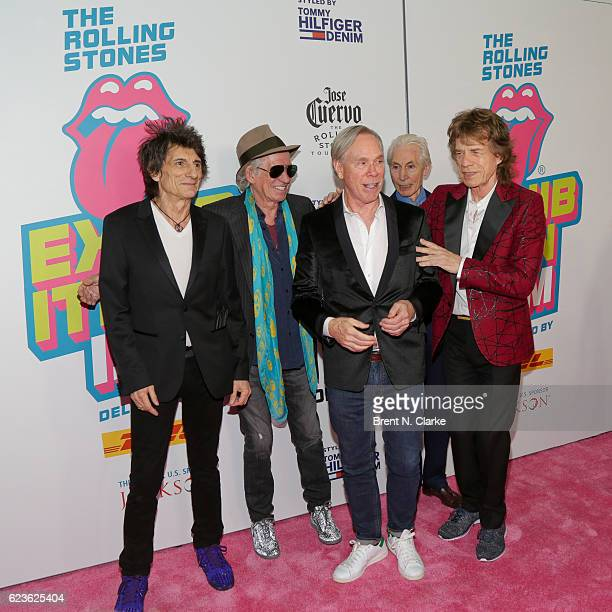 Guitarists Ronnie Wood Keith Richards designer Tommy Hilfiger drummer Charlie Watts and singer Mick Jagger attend The Rolling Stones Exhibitionism...