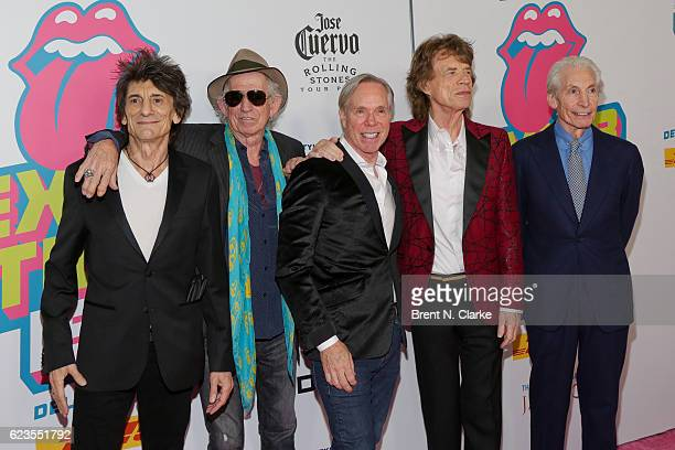 Guitarists Ronnie Wood Keith Richards designer Tommy Hilfiger singer Mick Jagger and drummer Charlie Watts attend The Rolling Stones Exhibitionism...