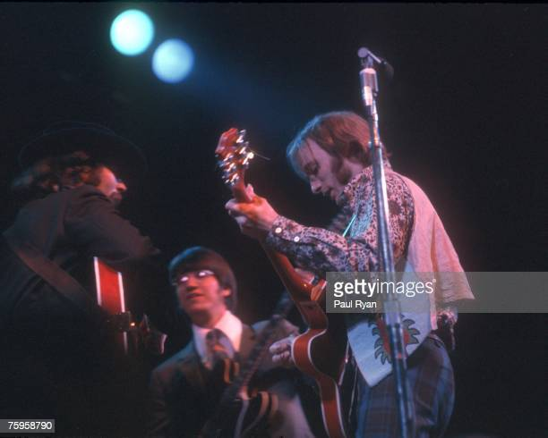 Guitarists Stephen Stills and Richie Furay of the supergroup 'Buffalo Springfield' perform onstage at the Monterey Pop Festival with David Crosby of...
