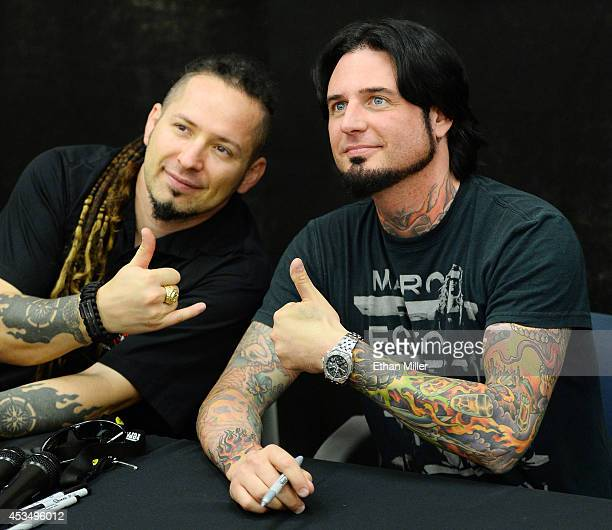 Guitarists Zoltan Bathory and Jason Hook of Five Finger Death Punch pose for photos at Nellis Air Force Base as the band highlights its campaign to...
