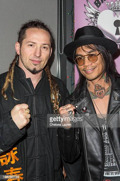 Guitarists Zoltan Bathory of Five Finger Death Punch and Stevie D of Buckcherry attend The Backstage Artist Lounge's 121212 industry event supporting...