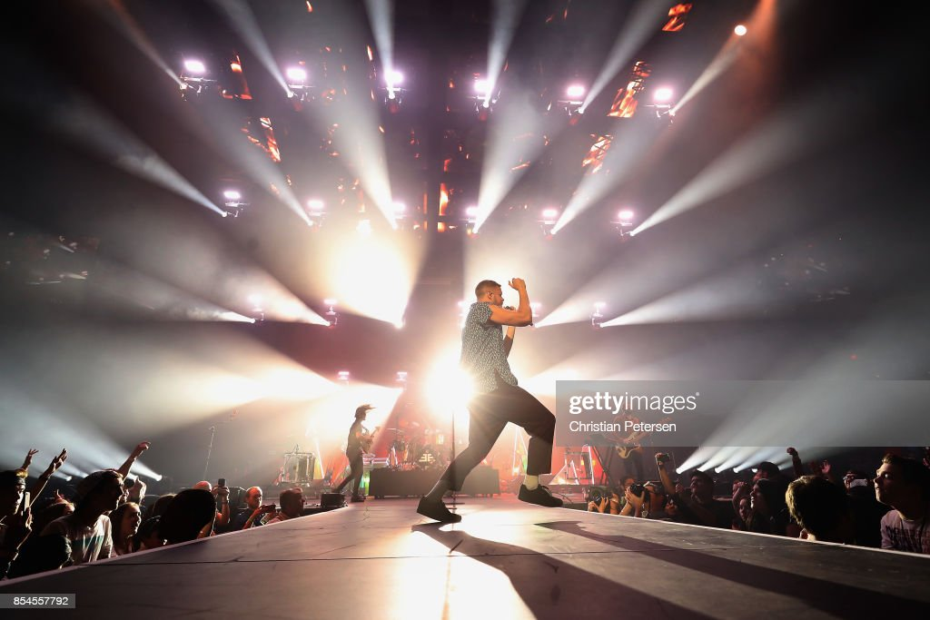 GuitaristWayne Sermon, drummer Daniel Platzman, frontman Dan Reynolds and bassist Ben McKee of Imagine Dragons perform at Talking Stick Resort Arena on September 26, 2017 in Phoenix, Arizona.
