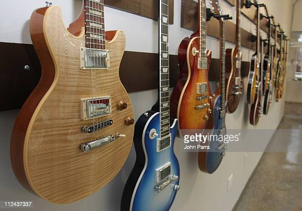 Guitars hang in a display at the Gibson Studio March 14 2008 in Miami Beach Florida