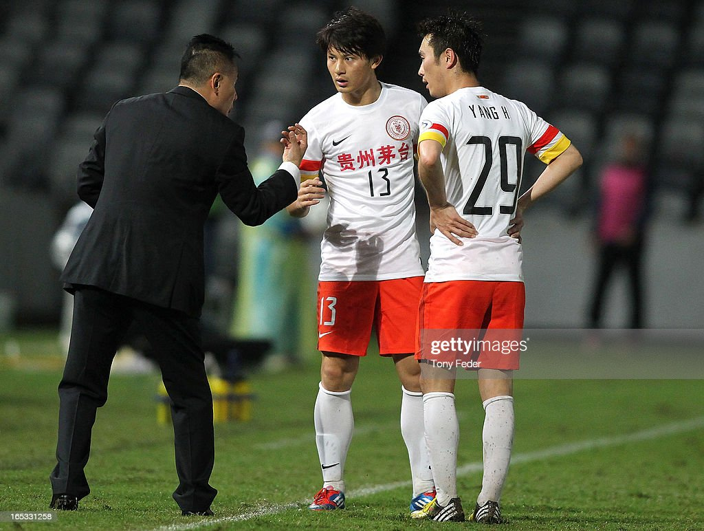 Guizhou coach <a gi-track='captionPersonalityLinkClicked' href=/galleries/search?phrase=Gong+Lei+-+Soccer+Coach&family=editorial&specificpeople=13825763 ng-click='$event.stopPropagation()'>Gong Lei</a> talks to players Shi Liang and Yang Hao during the AFC Asian Champions League match between the Central Coast Mariners and Guizhou at Bluetongue Stadium on April 3, 2013 in Gosford, Australia.