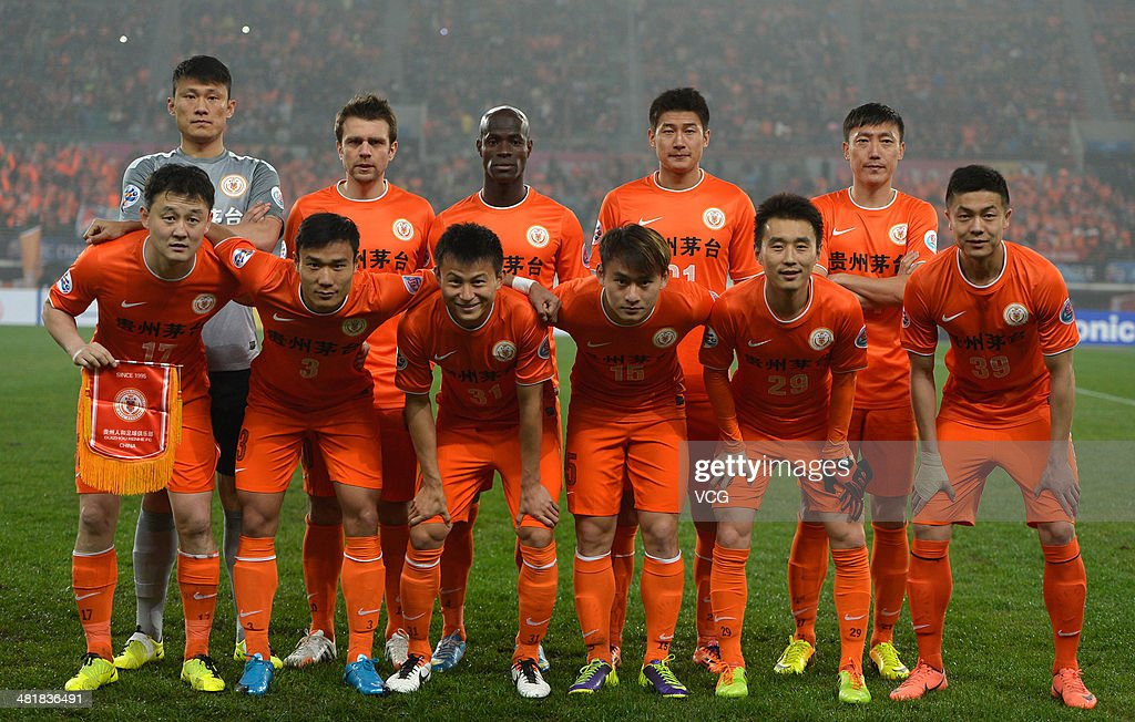 Guizhou Renhe players line up prior to the AFC Asian Champions League match between Guizhou Renhe and Ulsan Hyundai at Guiyang Olympic Centre on April 1, 2014 in Guiyang, China.