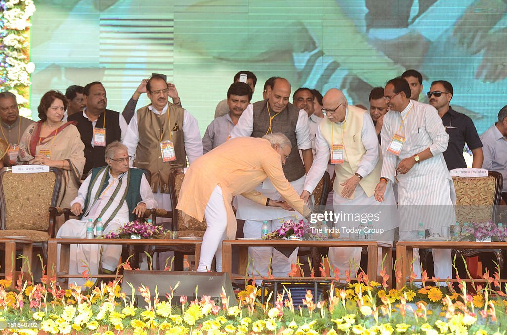 Gujarat Chief Minister and BJP's prime ministerial candidate Narendra Modi touching BJPs senior leader LK Advanis feet during a massive rally in Bhopal.