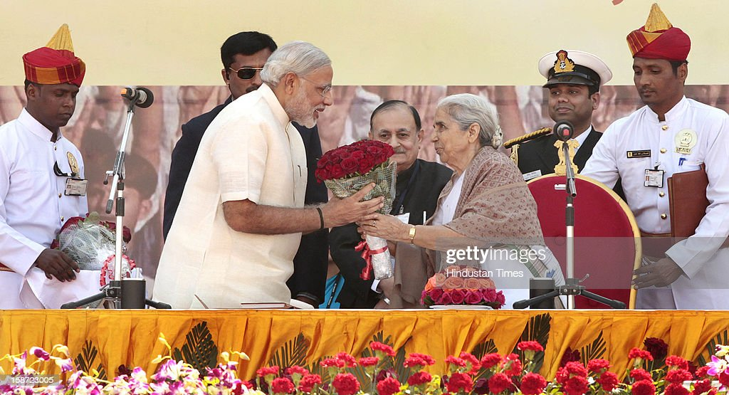 Gujarat Chief Minister Narandra Modi Narendra Modi accepting flowers from Gujarat governor Kamla Beniwal (R) during his swearing in ceremony at a grand function at Sardar Patel Stadium on December 26, 2012 in Ahmedabad, India. Narendra Modi sworn as Chief Minister of Gujarat for fourth successive term along with 16 ministers.