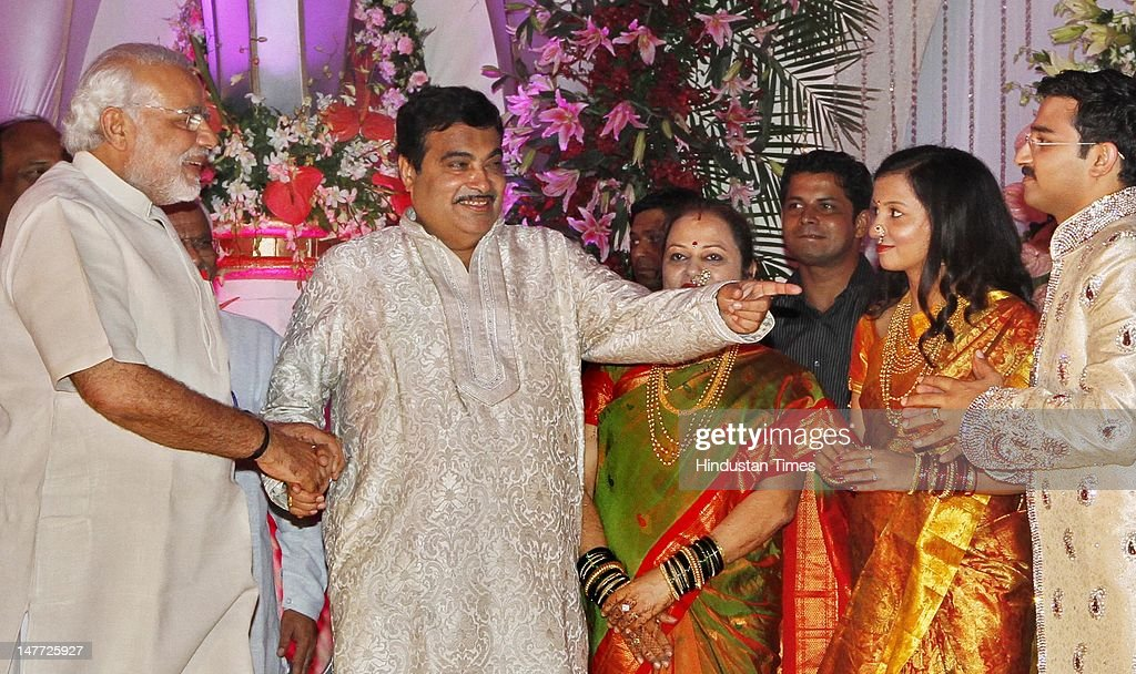 Gujarat chief minister Narender Modi greets Nitin Gadakri his wife Kanchan and newlywed couple of Sarang and Madhura during their wedding reception n July 2, 2012 in New Delhi, India. BJP President Nitin Gadkari's younger son Sarang Gadkari tied knot with his classmate Madhura on June 24, 2012 in Nagpur.