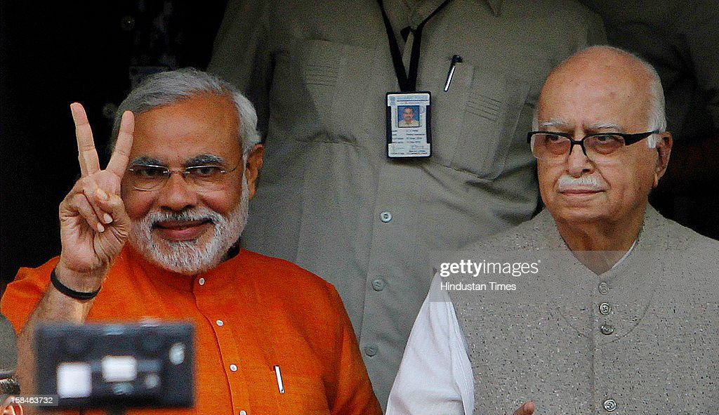 Gujarat chief minister Narendra Modi and BJP senior leader L K Advani at BJP Pradesh office on the day of last phase assembly poll at Ahmedabad on December 17, 2012 in Gujarat, India.