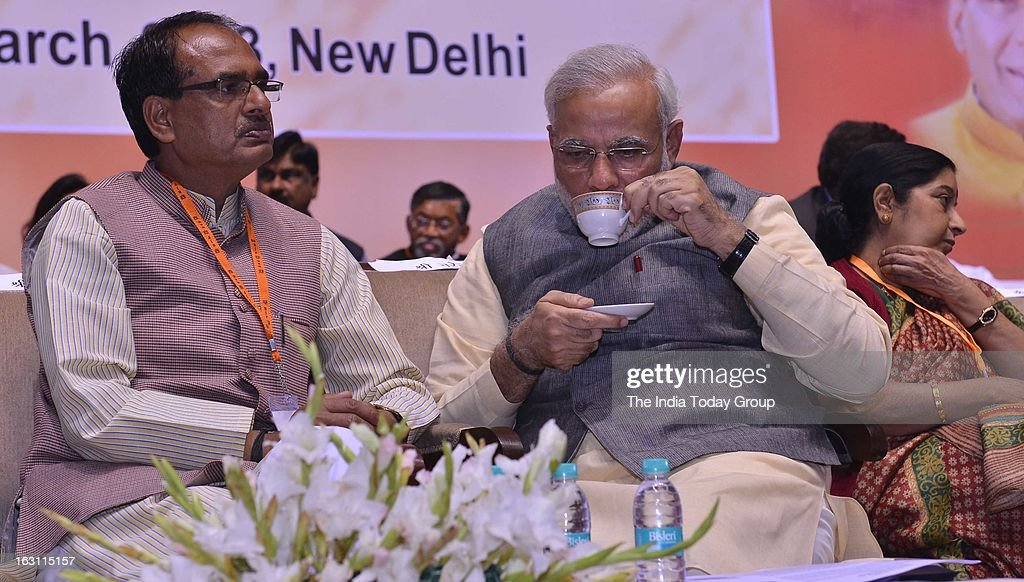 Gujarat Chief Minister Narendra Modi and Shivraj Singh Chouhan at BJP's 2-day national council meeting on Sunday, March 03, 2013.