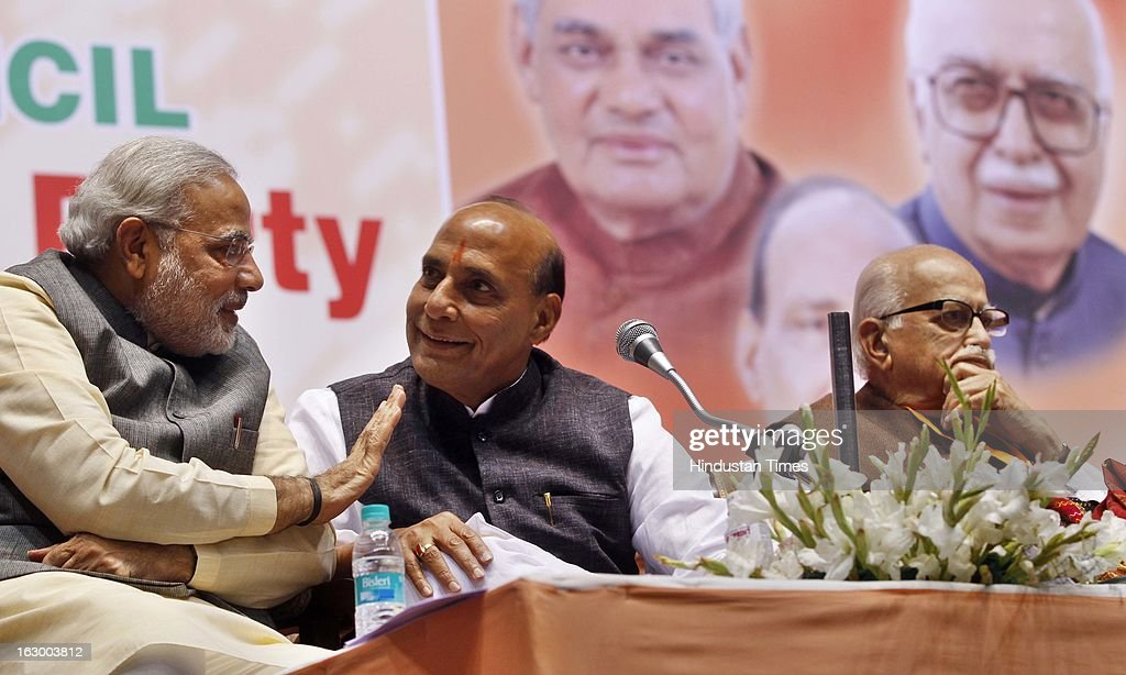 Gujarat Chief Minister Narendra Modi, BJP party president Rajnath Singh and Senior BJP leader L K Advani during the last day of the Party National Council Meeting on March 3, 2013 in New Delhi, India. Party meeting, which is aimed at strategising for the upcoming assembly and general elections as also looking at a reorganisation of the party structure.